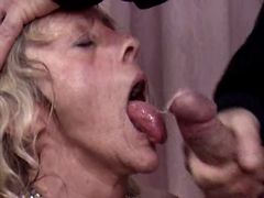 Mature gets facial in swinger orgy