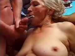 Lustful grandma gets cum in group
