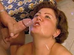 Busty mature gets facial